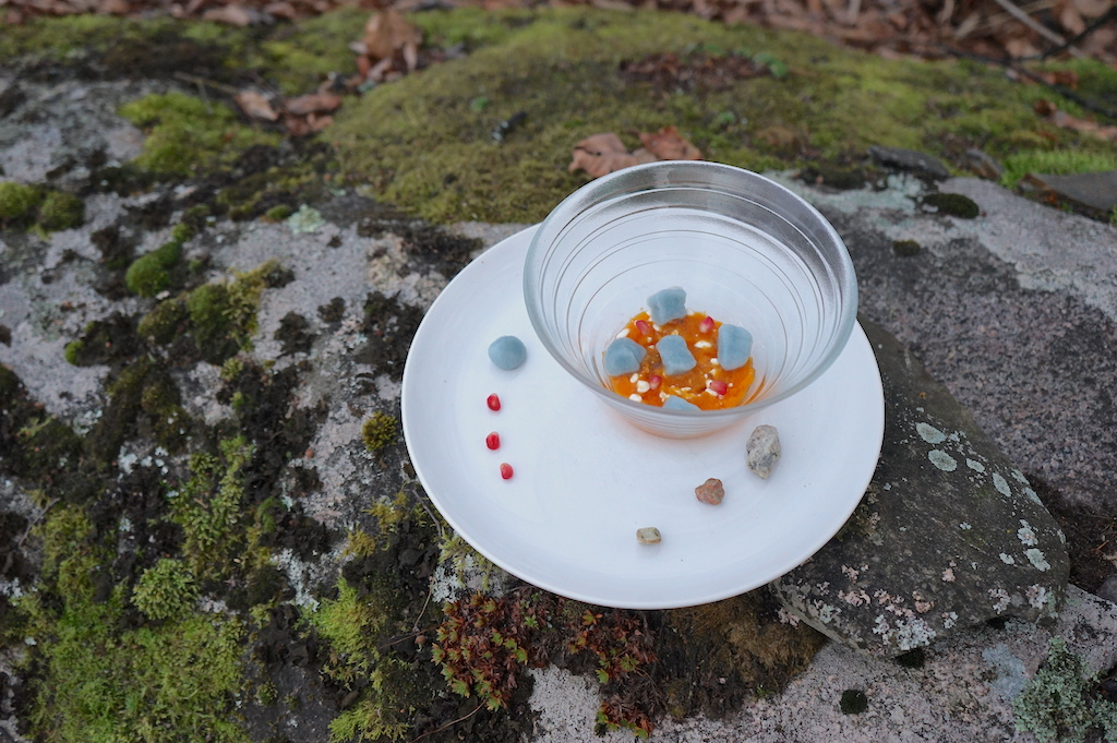 a white plate and a bowl on the rock