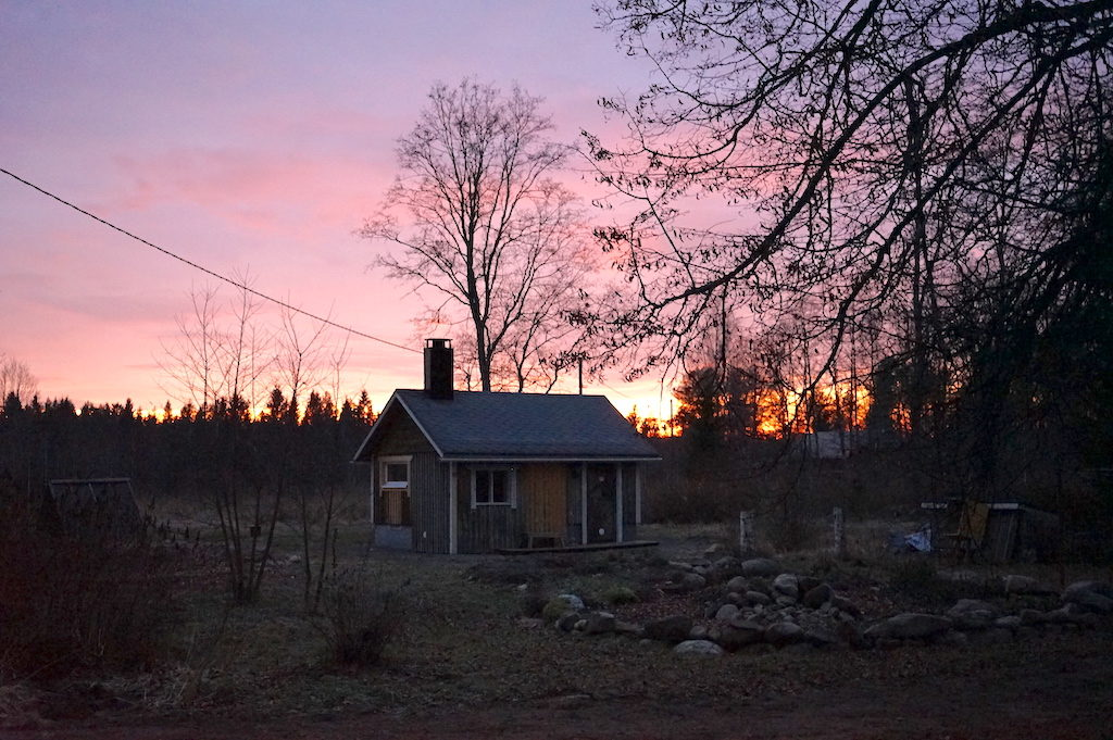 sunset in front of a sauna house